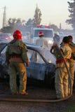 Crash site. Firemen at the scene of a car crash stock photos