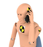 Crash Test Dummy Using Smart Phone Royalty Free Stock Photography