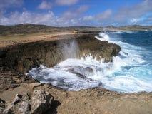 Crash of Waves. Waves crash against barren coastal bluffs Stock Photos