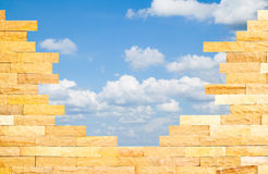 Crashed Brick Wall with blue sky behind Royalty Free Stock Photos