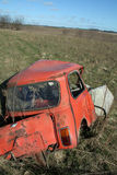 Crashed car in field Stock Photography