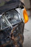 Crashed car headlight detail Stock Photos