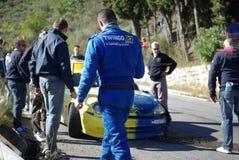 Crashed car during race Stock Photo