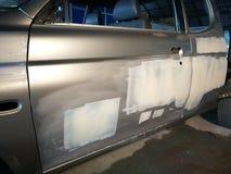 Car body repair. Crashed car in a repair station stock photos