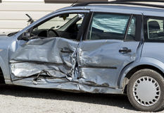 Crashed car side view Royalty Free Stock Images