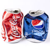 Crashed Cola and Pepsi cans. Vilnius, Lithuania - October 21, 2011: Studio photo of empty and crashed Coca-Cola and Pepsi 330 ml cans, isolated on white Stock Image