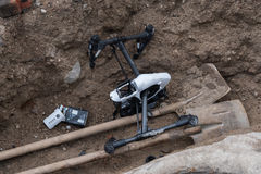 Crashed DJI Inspire quadcopter near the well. Moscow, Russia - May 28, 2017: Crashed DJI Inspire quadcopter on the construction sitel royalty free stock images