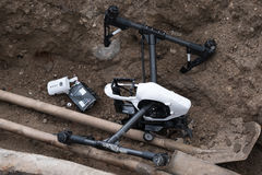 Crashed DJI Inspire quadcopter near the well. Moscow, Russia - May 28, 2017: Crashed DJI Inspire quadcopter on the construction sitel stock photography