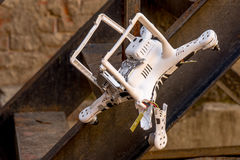 Crashed drone that stuck on the ladder Royalty Free Stock Image