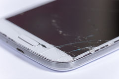 Crashed lcd touch screen on the white mobile phone Royalty Free Stock Image