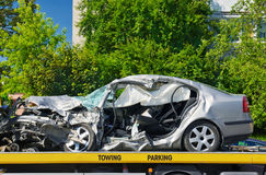 Crashed luxury car parked on a tow truck. Royalty Free Stock Photography