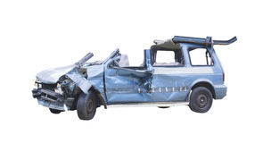 Crashed mini van. Crashed blue minivan with cut door posts to indicate extraction of occupants Stock Photo