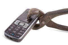 Crashed mobile phone. Crashed classical model of mobile phone in naildrawer isolated on white royalty free stock image