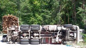 Crashed overturning truck with firewood Stock Photo