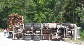 Crashed overturning truck on road Royalty Free Stock Images