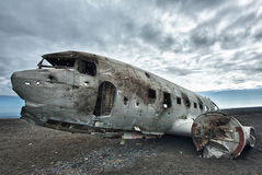 Crashed palne. Wreck of a US military plane crashed in the middle of the nowhere. The plane ran out of fuel and crashed in a desert not far from Vik, South Royalty Free Stock Photo