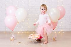 Crashed party background - cute little girl and smashed cake ove Stock Photos