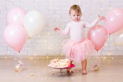 Crashed party background - little girl and smashed cake over brick wall with lights and balloons. Crashed party background - little girl and smashed cake over stock image