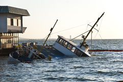 Crashed passenger ferry. Is sinking and makes a shipwreck Royalty Free Stock Image