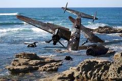 Crashed plane. World war II crashed plane on the sea coast Royalty Free Stock Photo