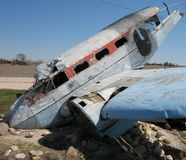 Crashed plane. Wrecked plane nose into ground royalty free stock image