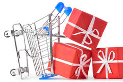 Crashed shopping cart with gifts stock image
