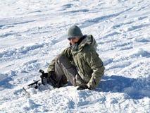 Crashed snowboarder Stock Photography