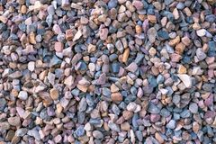 Beautiful texture of colored small stones, background of stones stock photos