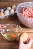 Crashing eggs for preparing food Royalty Free Stock Photography