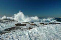 Crashing Ocean Waves. Image taken of waves crashing over rocks along the Sydney rock walls in New South Wales Australia Stock Photos