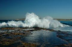 Crashing Ocean Waves. Image taken of waves crashing over rocks along the Sydney rock walls in New South Wales Australia Stock Images