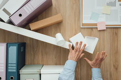 Crashing shelf in the office stock images