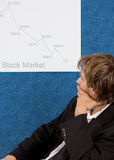 Crashing stock market. Stock broker analyzing stock chart Stock Photos