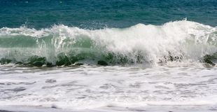 Crashing Wave. A wave crashing on the shore stock photos
