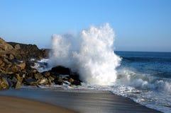 Crashing wave. Wave crashing on rocks stock image