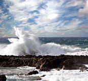 Crashing wave. A wave crashes into the land Royalty Free Stock Images