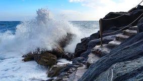 Crashing Wave. Close Crashing wave in rough conditions at Riomaggiore, Cinque Terre, Italy Stock Photo