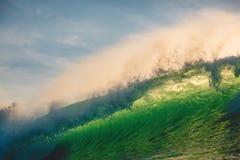 Crashing wave in ocean. Breaking green wave and sun light in Bali. Crashing wave in ocean. Breaking green wave and sun light Royalty Free Stock Photos