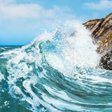 Crashing Wave. A wave crashing on the rocky shore at Gaviota State Beach in Central California stock photography