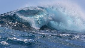 Crashing wave. Tropical blue curl, off the coast of Oahu, Hawaii.  Tradewind formed channel surf Royalty Free Stock Images