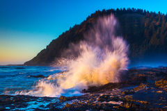 Crashing Wave. Wild Wave Crashing Into Rocky Shore Along Oregon Coast Near Cape Perpetua  At Sunset Stock Photos