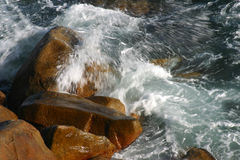 Crashing waves. Over granite boulders at puerto vallarta mexico Royalty Free Stock Images