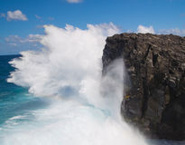 Crashing waves. Powerful crashing waves against rocks in Mauritius royalty free stock photo