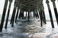 Crashing Waves. Waves crashing to shore under the pier Royalty Free Stock Photography