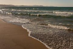 Crashing waves on beach in Coromandel Peninsula Royalty Free Stock Photo
