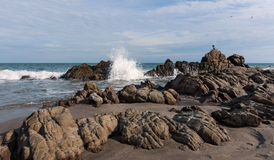 Crashing Waves at El Faro, Ecuador. Crashing waves along the rocky beach at El Faro, Ecuador Stock Photo