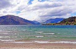 Crashing waves on a mountain lake Stock Photography
