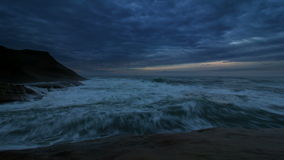 Crashing Waves and Moving Clouds Time Lapse Sunset into Blue Hour at Cape Kiwanda in Pacific City Oregon 1080p stock video footage