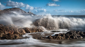 Crashing waves. And Mumbles lighthouse on the Gower peninsula, South Wales royalty free stock photos