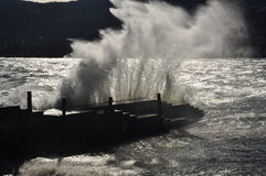 Crashing waves on a pier, lago Maggiore Stock Photo